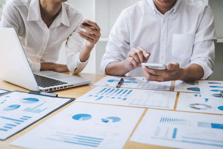 Business casual team manager having a discussion with new project success financial statistics, Partner meeting professional investor working start up project for both company with document.