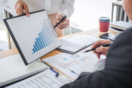 Two business team discussing and planning strategy company growth project success financial statistics, Partner meeting professional investor working start up project for both company with document.