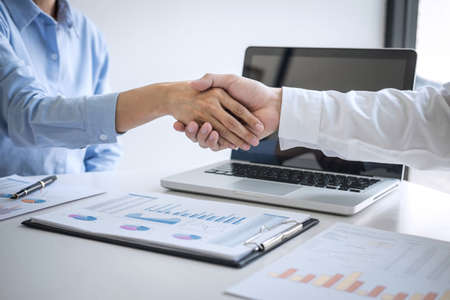 Finishing up a meeting, Business handshake after discussing good deal of Trading to sign agreement and become a business partner, contract for both companies, Successful businessman handshake.