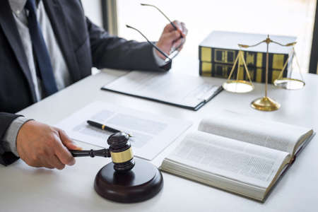 Judge gavel with Justice lawyers, Counselor in suit or lawyer working on a documents in courtroom, Legal law, advice and justice concept.