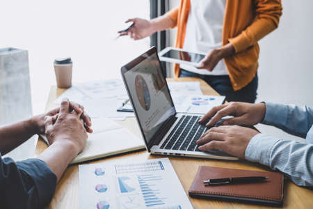 Business team collaboration discussing working analyzing with financial data and marketing growth report graph in team, presentation and brainstorming to strategy planning making profit of company. Stock Photo