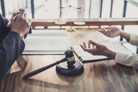 Male lawyer or judge consult having team meeting with Businesswoman client, Law and Legal services concept. Stock Photo
