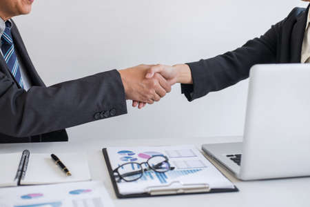 Business partnership meeting, Two confident Business handshake and business people after discussing good deal of Trading contract and new projects for both companies, success, partnership.