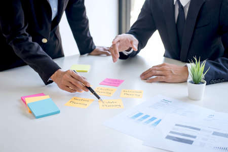 Business team executive accounting analyzing and calculation on valuation data investment fund looking at report, sticky note paper and having a consultation, Wealth Management and investment concept. Stock Photo - 128808490