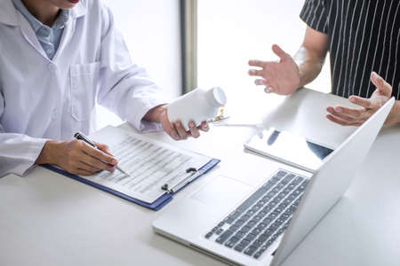 Doctor presenting report of diagnosis, symptom of disease and recommend something a method with patient treatment, after results about the problem illness of patient.