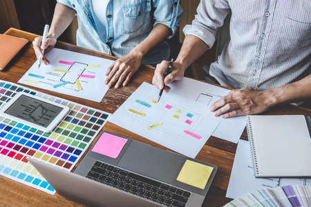 Team of Creative Web/Graphic Designer planning, drawing website ux app for mobile phone application and development template layout, process to developing prototype wireframe, User experience concept. Stock Photo - 128808910