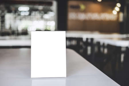 Mock up acrylic frame posters pattern template forms background, blank menu frame on table in coffee shop or restaurant stand for your text of display your product. Stock Photo