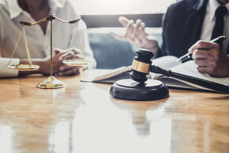 Male lawyer or Counselor working in courtroom have meeting with client are consultation with contract papers of real estate, Law and Legal services concept.