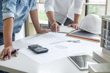 Architecture Engineer Teamwork Meeting, Drawing and working for architectural project and engineering tools on workplace, concept of worksite on technical drawing structure and construction.