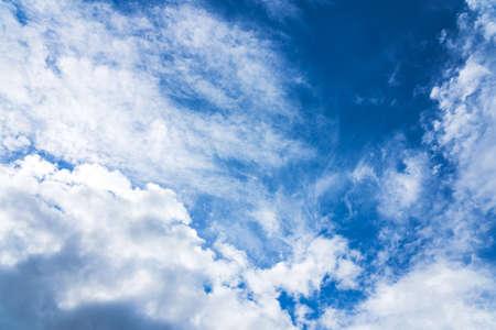 Blue sky with white clouds under sunshine. Reklamní fotografie