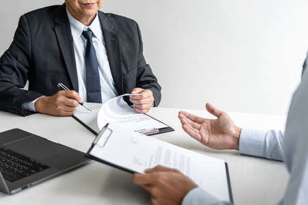 Job interview, Senior selection committee manager asking questions to applicant about work history, colloquy dream, Skill, expertise, experience and businessman listen to candidate answers. Standard-Bild
