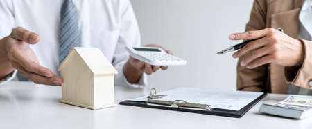 Real estate broker agent talk reach contract form presenting and consult to customer to decision making sign insurance form agreement with approved mortgage application form insurance.