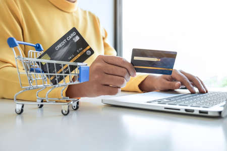 Woman using credit card register security code payments online shopping and customer service network connection market, using technology on laptop, Internet Online shopping or banking concept.