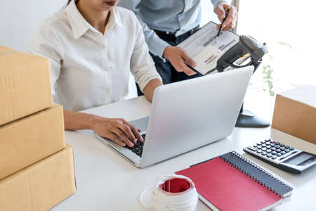 Shipment Online Sales, Small business or SME entrepreneur owner delivery service and working packing box, business owner working checking order to confirm before sending customer in post office. Archivio Fotografico