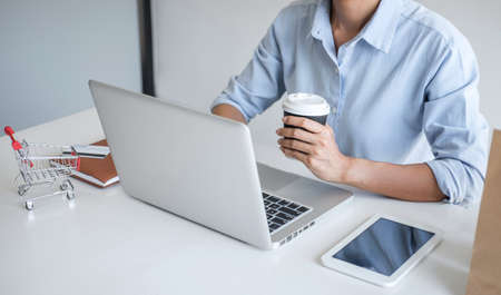 Woman using credit card register security code and payments online shopping and customer service network connection market, using on laptop, Internet Online shopping or internet banking concept.