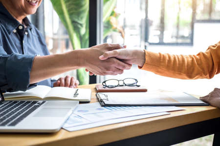 Successful of business deal, Business partnership meeting and handshake after discussing good deal agreement and become a partner of trading contract and new projects for both companies.