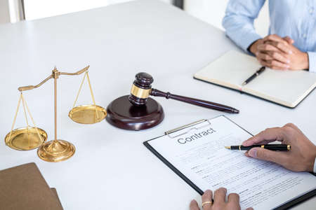 Consultation and conference of Male lawyers and professional businesswoman working and discussion having at law firm in office. Concepts of law, Judge gavel with scales of justice. Banco de Imagens