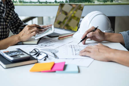 Architecture Engineer Teamwork Meeting, Drawing and working for architectural project and engineering tools on workplace, concept of work on technical drawings. Stockfoto