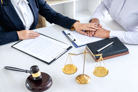 Female lawyer or Counselor working in courtroom have meeting with client are consultation with contract papers of real estate, Law and Legal services concept. Stockfoto