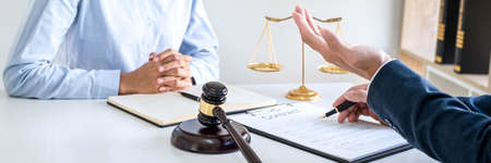 Consultation and conference of Male lawyers and professional businesswoman working and discussion having at law firm in office. Concepts of law, Judge gavel with scales of justice. Stock Photo