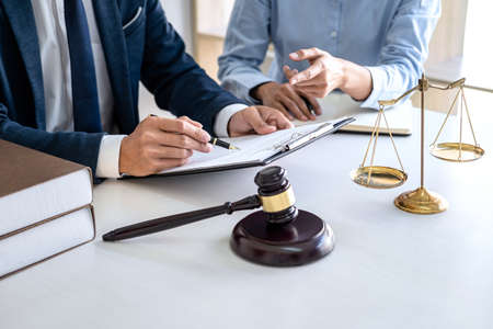 Businesswoman and Male lawyer or judge consult and conference having team meeting with client at law firm in office, Law and Legal services concept.