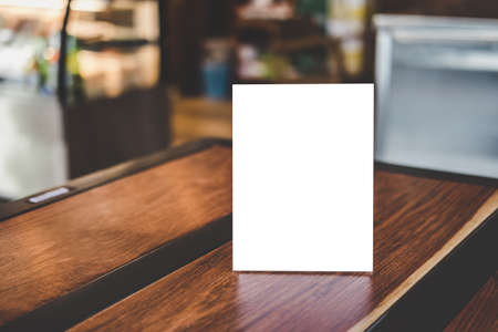Mock up acrylic frame posters pattern template forms background, blank menu frame on table in coffee shop stand for your text of display your product. Stockfoto