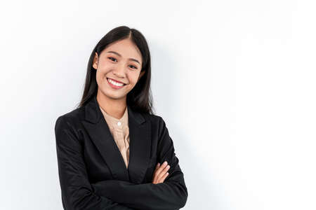 Portrait of Smiling asian happy business woman with crossed arms and looking at the camera.