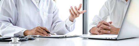 Doctor consulting patient discussing something symptom of disease and recommend treatment methods, presenting results on report and prescription, Medicine and health care concept. Standard-Bild