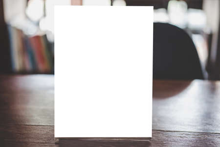 Mock up acrylic frame posters pattern template forms background, blank menu frame on table in coffee shop stand for your text of display your product. Standard-Bild