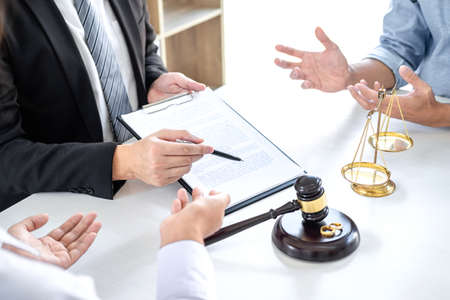 Unhappy divorce couple having conflict, Man and wife conversation during divorce process with male lawyer or counselor.