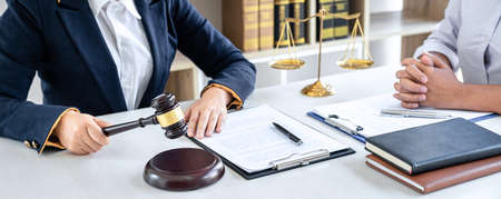 Female lawyer or Counselor working in courtroom have meeting with client are consultation with contract papers of real estate, Law and Legal services concept. Banque d'images