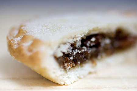 mince pie: Side up and close view of fresh crusty mince pie cut in half to show filling