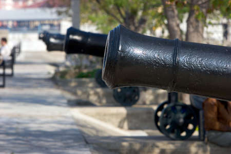 moveable: Row of original, cast iron and historical cannons in Gibraltar on a sunny day