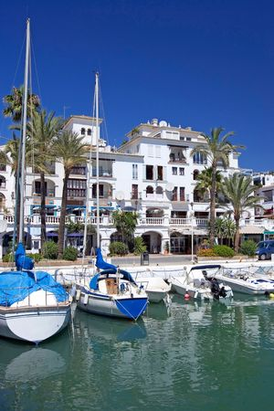 sol: Beautiful white boats and yachts moored in Duquesa port in Spain on the Costa del Sol Stock Photo