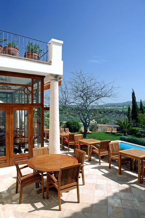 staying in shape: Large rustic hotel and swimming pool set in beautiful gardens in the Spanish countryside