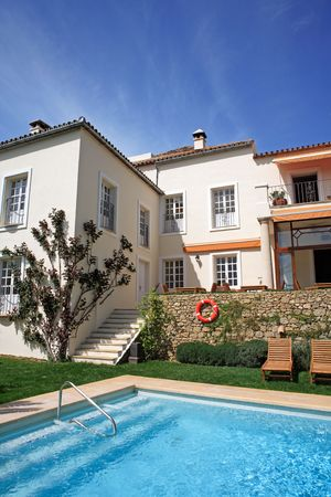a bathing place: Large rustic hotel and swimming pool set in beautiful gardens in the Spanish countryside
