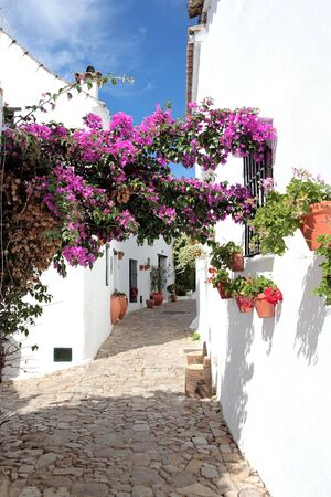andalucia: Narrow, cobbled streets and pretty houses of Spanish Pueblo at Castillo de la Frontera in Andalucia southern Spain Stock Photo