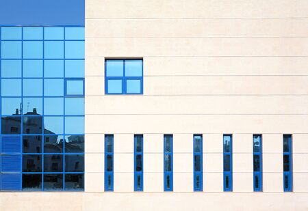 mirrored: Stunning architecture and blue mirrored windows of modern building in Spain