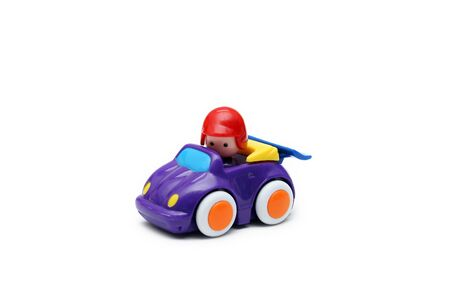 purple car: Childrens toy purple car with toy driver inside Stock Photo