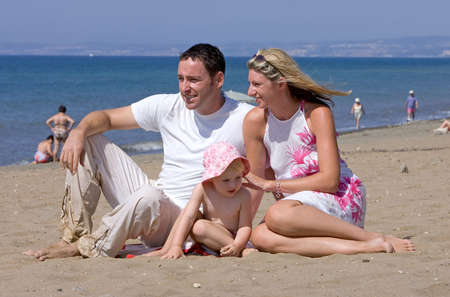 Young attractive family on beach vacation in Spain on the Costa del Sol on a sunny day Stock Photo - 2240575