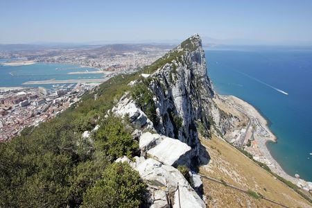 vertigo: View of tip of Rock of Gibraltar looking out to sea and the Spanish coast beyond Stock Photo