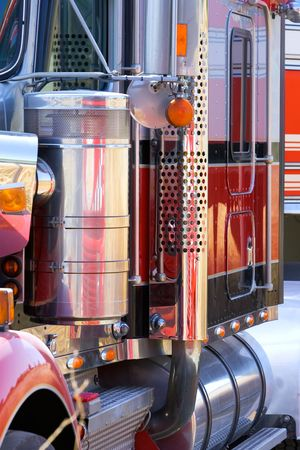 bodywork: Close up view of side of large truck of lorry with red bodywork and lots of chrome Stock Photo