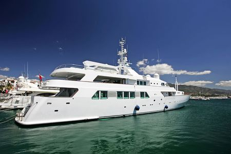 moored: Big, beautiful, stunning and luxurious white yachts moored in harbour or port in Spain on a sunny day. Stock Photo