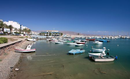 moored: Small fishing boats and yachts moored in Roquets del Mar port or harbour on the Costa del Almeria in Spain.