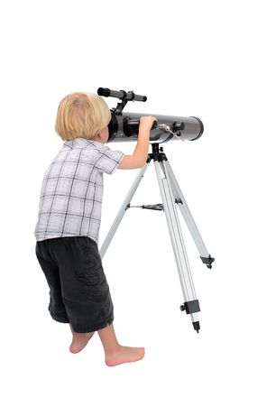 stargazing: Young child or boy standing up and looking at stars through a large astrological telescope on tripod with white, isolated background