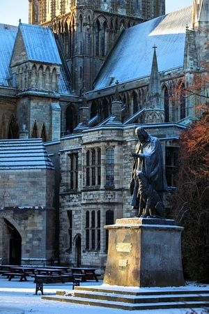 laureate: Statue of Alfred Tennyson the Poet Laureate and his dog at Lincoln Cathedral