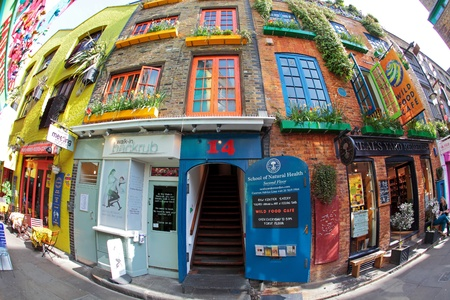 covent: Neals Yard in London with spectacular colours and flora everywhere through fisheye lens Editorial