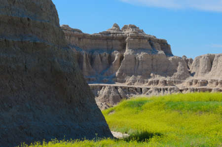 scoria: Scenic view of the Badlands National Park with wildflowers in the foreground in South Dakota in spring Stock Photo