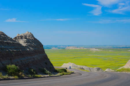 stria: Famous Badlands Loop Road in Scenic view of the Badlands National Park with wildflowers in the foreground in South Dakota in spring Stock Photo