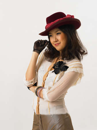 fair skin: Young woman wearing hat LANG_EVOIMAGES